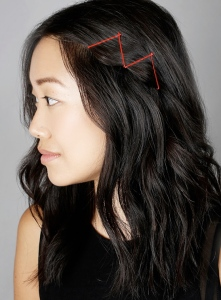 Red bobby pins in zig zag pattern